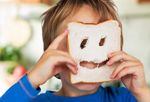 493ss_thinkstock_rf_small_boy_with_slice_of_white_bread